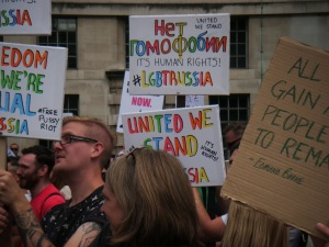 crowd scene with colourful placards
