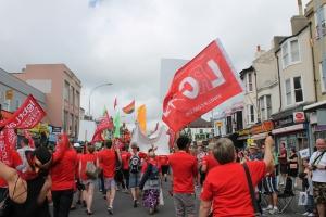 LRC flag waved behind Linda Taylor